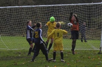 Joel denied with a header as the 'keeper saves....