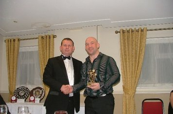 Andy Wright receiving coaches award from Jamie Elsmore