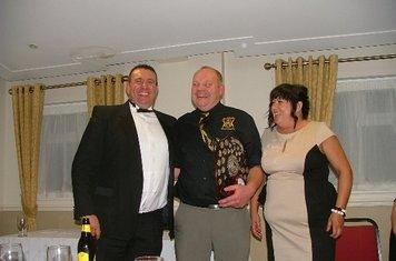 Wayne Sharkey & wife receiving Clubman of the year