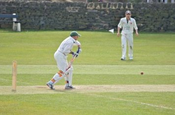 Anslow looks on from mid-wicket