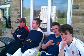 the lads chill on the balcony