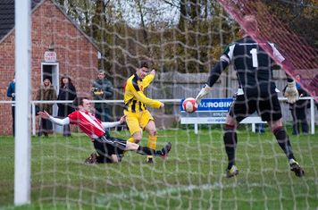Dave Leigh stretches to distract the striker