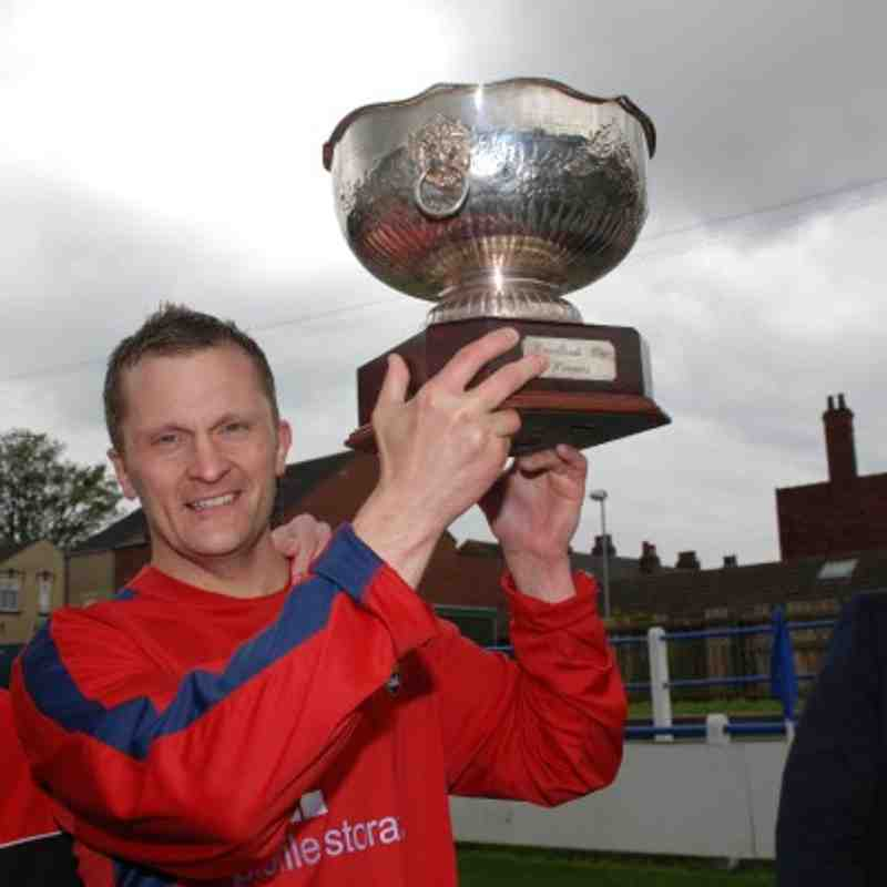 Redoubt skipper Mark Alvey holds aloft the prestigious Landlord's Trophy.