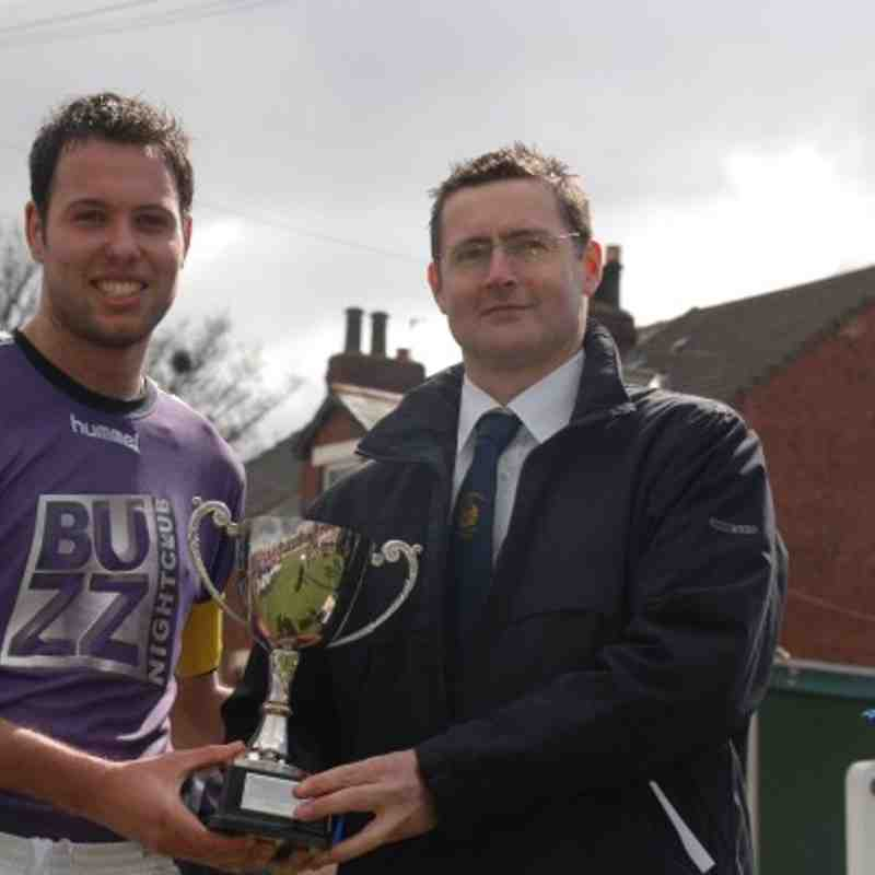 League Chairman Mr. A. Wilkinson presents the Division Three Cup to NW Eagles skipper Ben Kamara.
