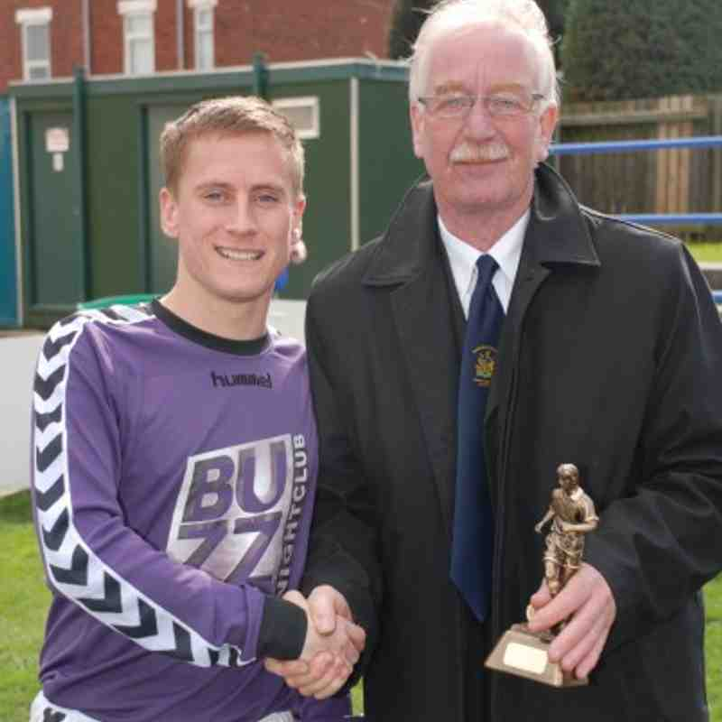LMC member Mr T. Whelan presents NW Eagles Man of the Match Lewis Rowland with his trophy.