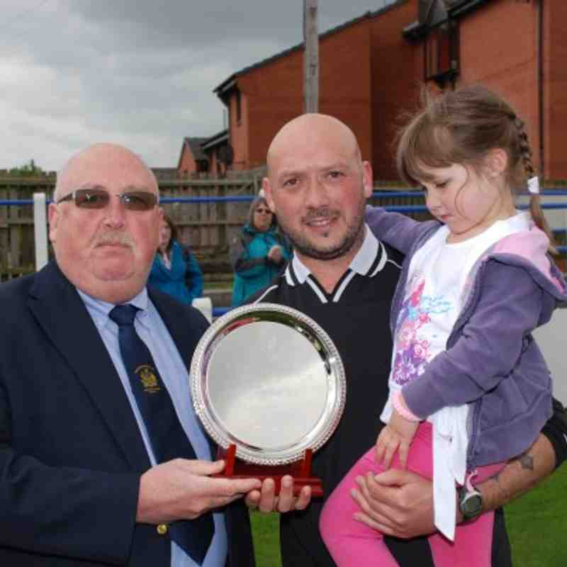 League Secretary Mr D. Joyce presents Referee Of The Year, Mark Campbell with his award. Daughter Adiana looks on proudly.