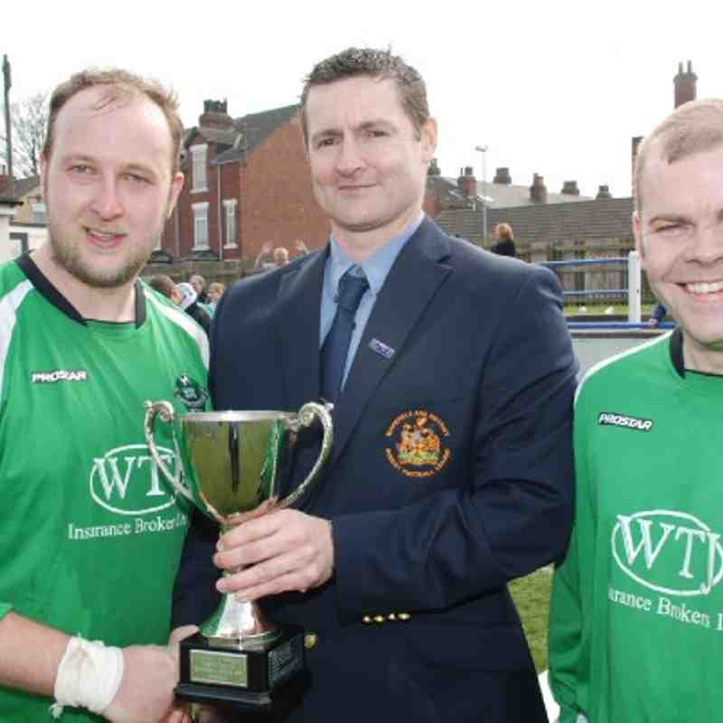 W&DSFL Chairman Adie Wilkinson presents the Division Four Cup to Dave Woollin and Carr Gate captain Chris Bragg.