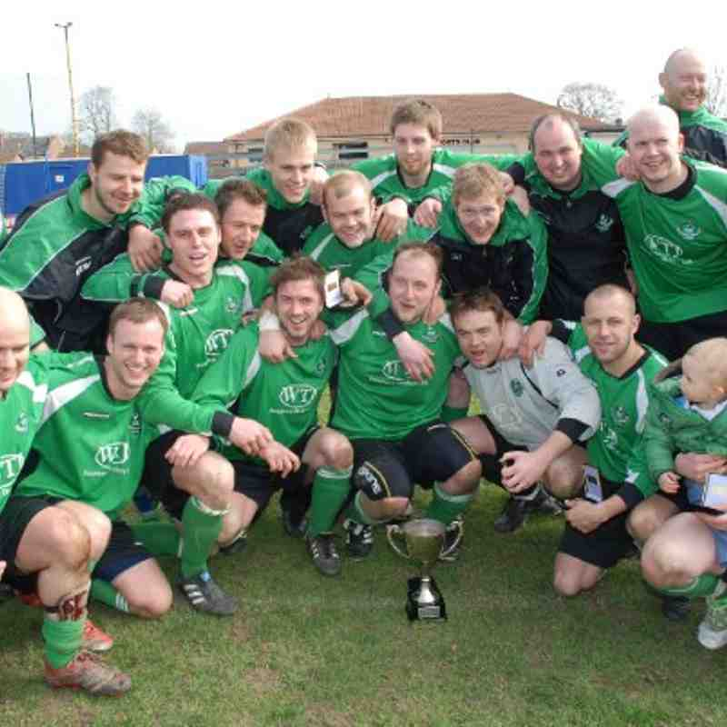 The jubilant Carr Gate team celebrate Cup success in their first season with the League.