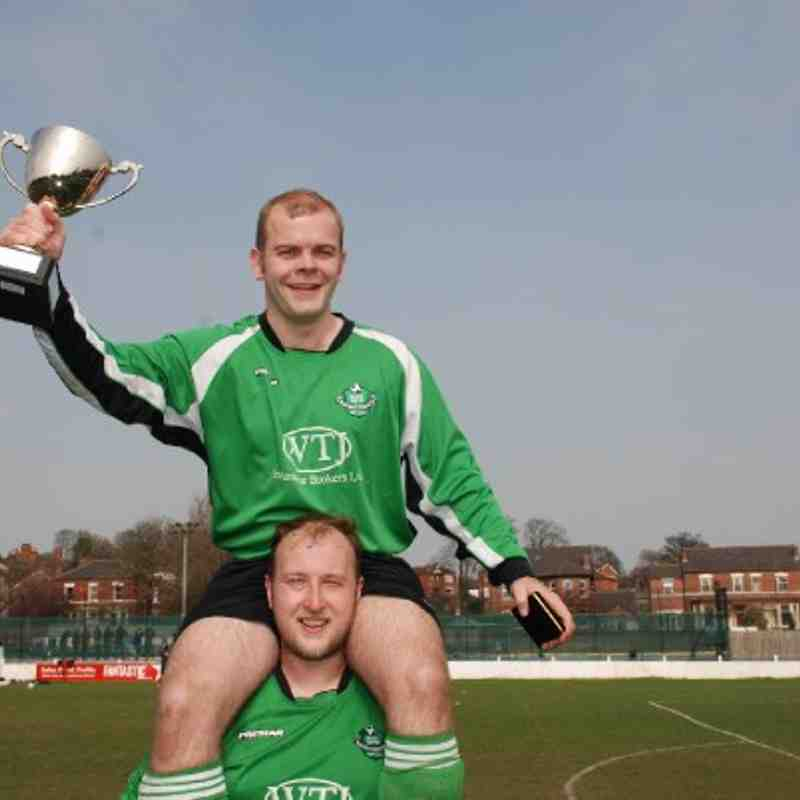Carr Gate captain Chris Bragg holds the Division Four Cup aloft as Dave Woollin holds him aloft!