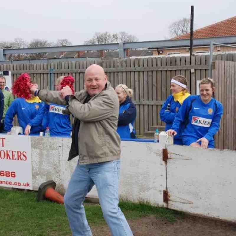 Gimme a 'C'! Gimme an 'A'! Gimme an 'R'! Gimme an 'R'! etc.  A jubilant Carr Gate supporter pulls out the pom-poms for a mini-party all of his own!