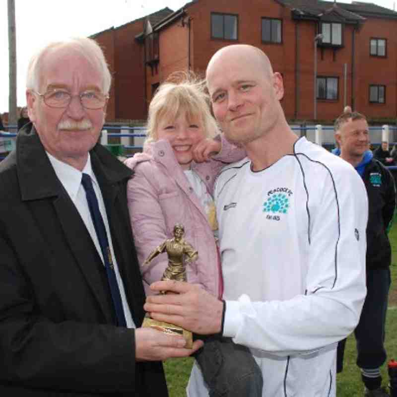 Rollinson / Clapperton Man of the Match Matty Kaye accepts his award from Registration Secretary Terry Whelan as a very proud young lady basks in dad's glory!