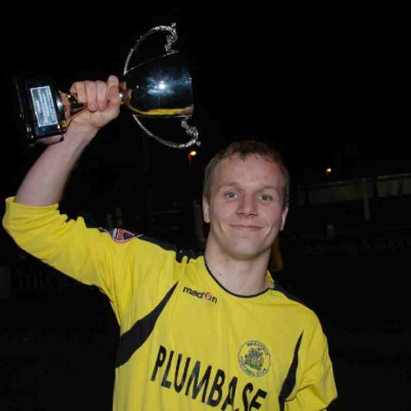 Fleece Reserves skipper Matthew Patterson celebrates with the Division Three League Cup.