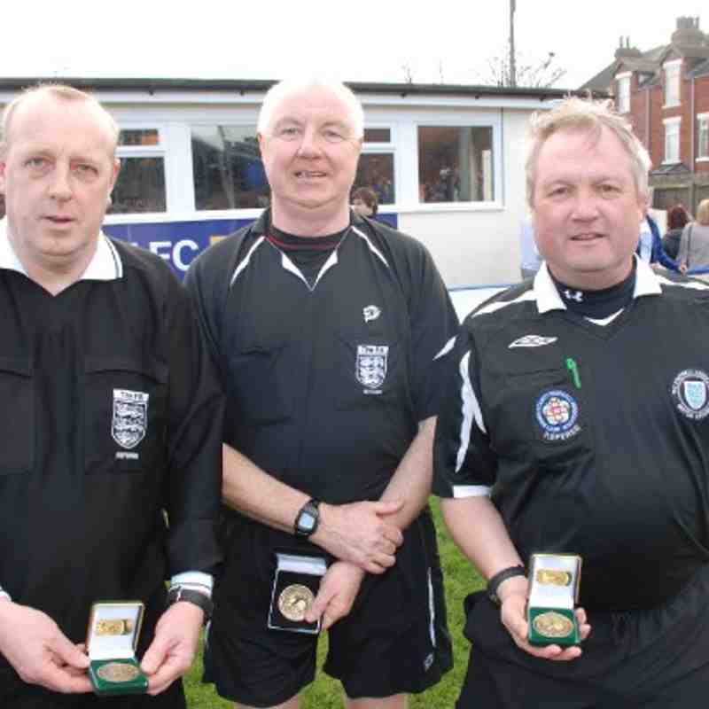 Division Two Cup Final match officials from left;