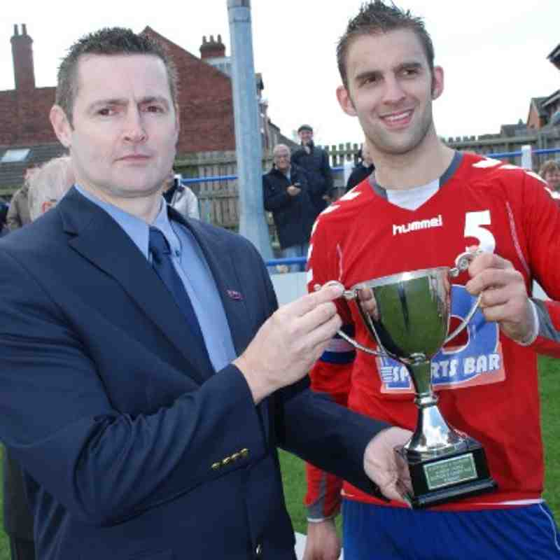 W&DSFL Chairman Mr. Adie Wilkinson presents the Division Two League Cup to HD Sports Bar captain Jon Forrest.