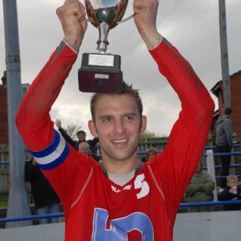 HD Sports Bar skipper Jon Forrest hoists the Division Two League Cup after despatching New Pot Oil 7-2 in the final.
