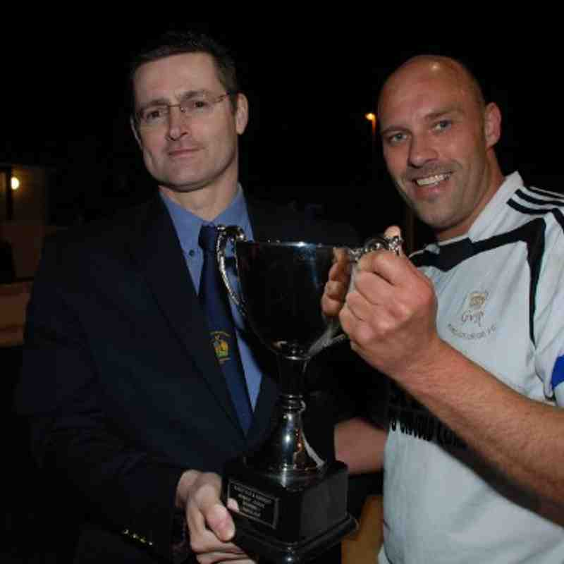 League Chairman Adie Wilkinson presents the Division One League Cup to a delighted Darren Lupton.