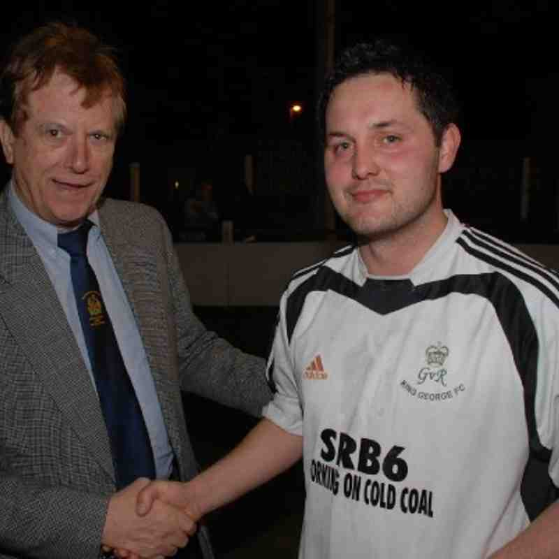 Referees' Secretary Brian Fox congratulates King George's Col Lovell on scooping the Man-Of-The-Match award.