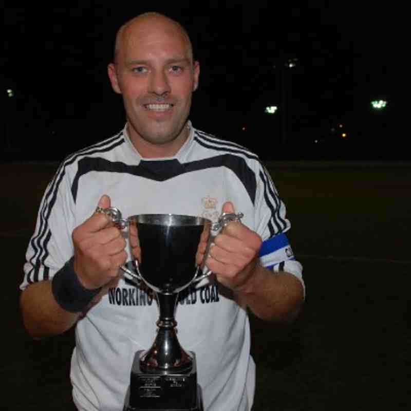 King George skipper Darren Lupton celebrates League Cup success for King George.