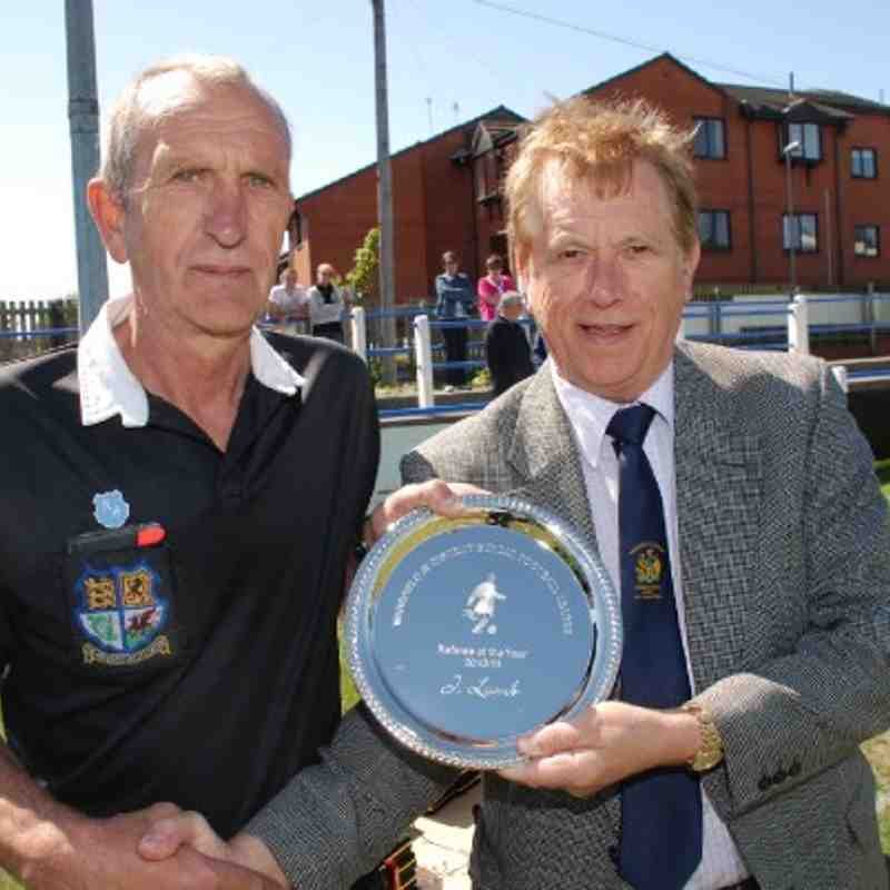 Referee Of The Year Jack Lumb accepts his trophy from Referees Secretary Brian Fox.