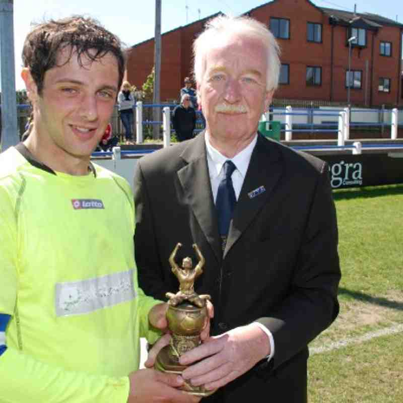 Kinsley Hot-shot Liam Radford is delighted to accept the man of the match award from Registration Secretary Terry Whelan after the Landlords Trophy Final.