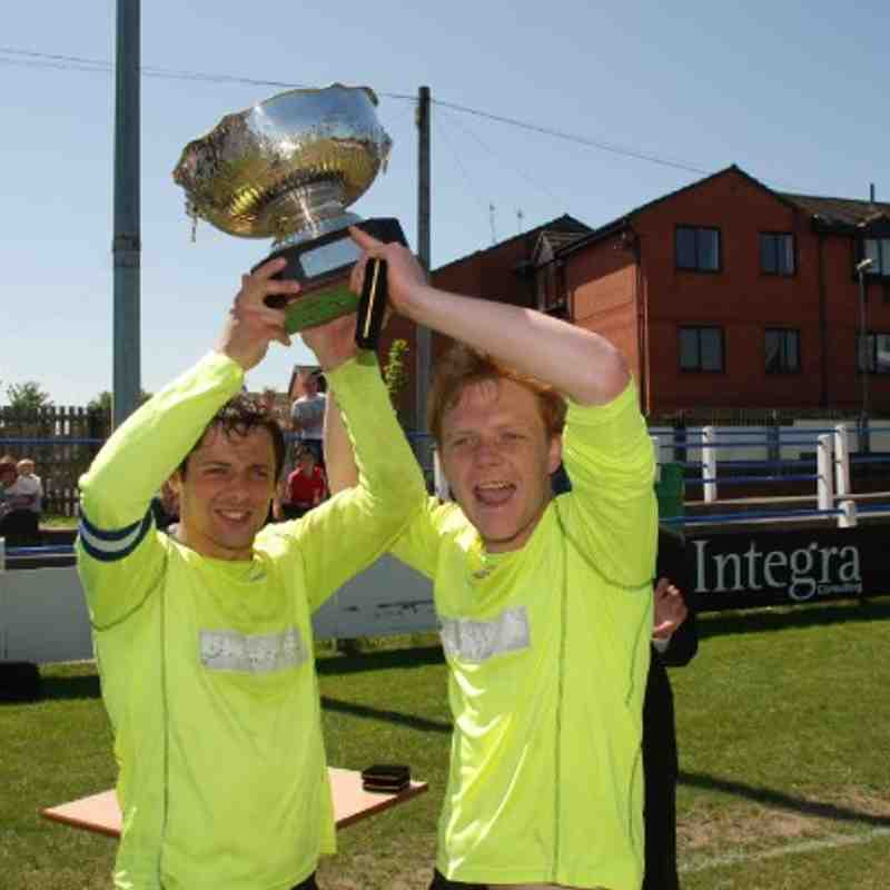 Kinsley Hotel skipper Liam Radford (L) and Lee Holdsworth (R) lift the Landlords Trophy following their 1-0 defeat of Shepherds Arms.