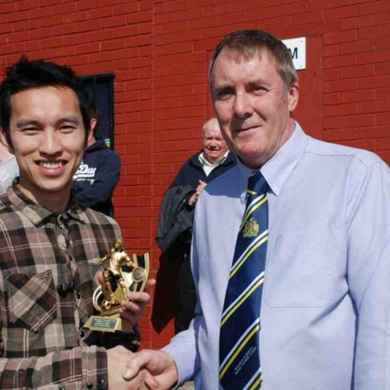LMC Member Chris Grace presents the coveted man-of-the-match award to King George's David Ly.
