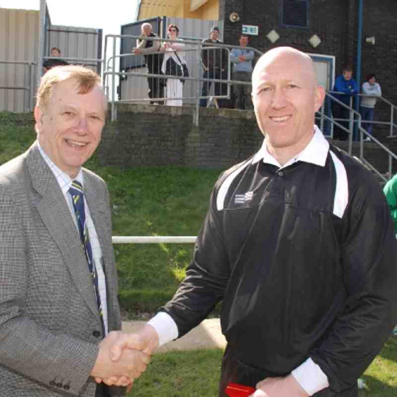 Assistant John Spink receives his Cup Final medal from Referees Secretary Mr. Brian Fox