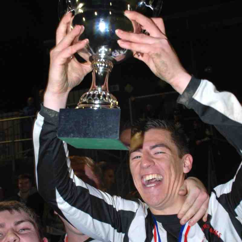 Shepherd Arms skipper Luke Thompson lifting the Premier Division League Cup following his sides extra-time success over Kinsley Hotel.
