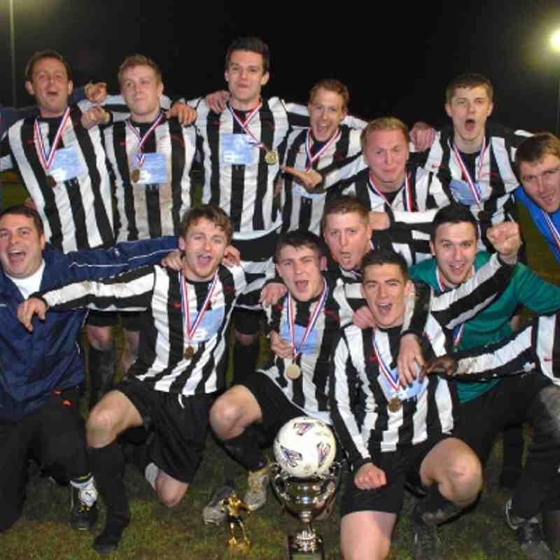 Victorious Shepherds Arms celebrate their last gasp extra-time 2-1 success over Kinsley Hotel in the Premier Division League Cup Final.