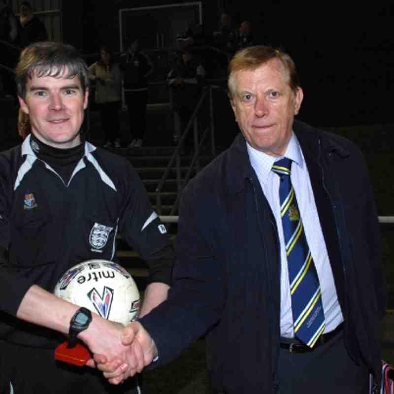 Referee Secretary Brian Fox congratulates referee Kevin Kelly