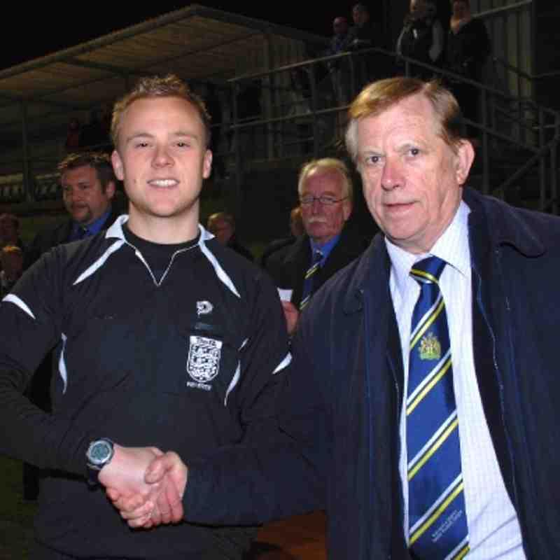 Referee Secretary Brian Fox congratulates Michael Trevethan
