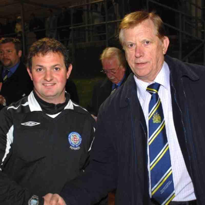 Referee Secretary Brian Fox congratulates referee Pat McTigue