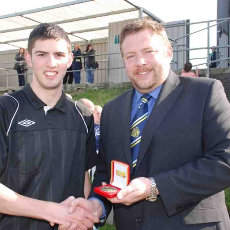 Assistant Referee Johnny Hughes receives his Cup Final medal from League Secretary Mr. Jon Scargill