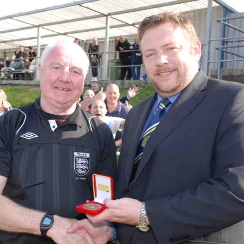 Assistant Referee Trevor Chalkley receives his Cup Final medal from League Secretary Mr. Jon Scargill