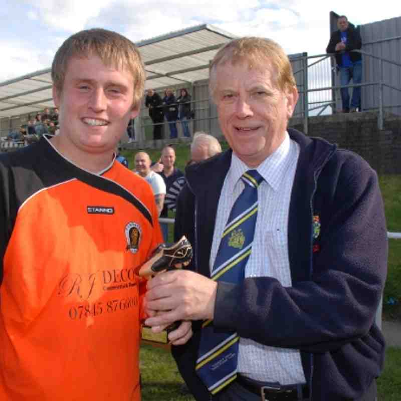Comrades' Josh Corbett receives the coveted Man-Of -The-Match award from Referees Secretary Mr. Brian Fox.
