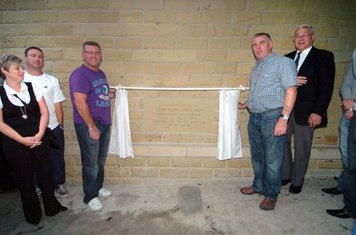 2 of Club Founder Stan Rowland's sons, Chris & Mark, unveil the Foundation Stone dedicated to Stan.