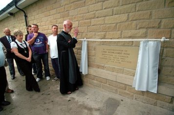 Father Antony Grant CR from the Church of the Resurrection blesses the Foundation Stone & Clubhouse