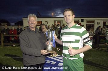 Skipper Phil Hatfield presented with the Belli Cup.