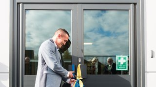 LS27 FC Ambassador Josh Warrington cuts the ribbon at Asquith Primary School
