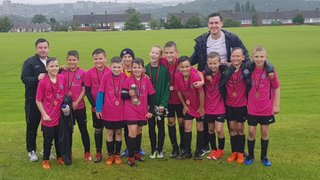 Steely U11 Whites lift the cup