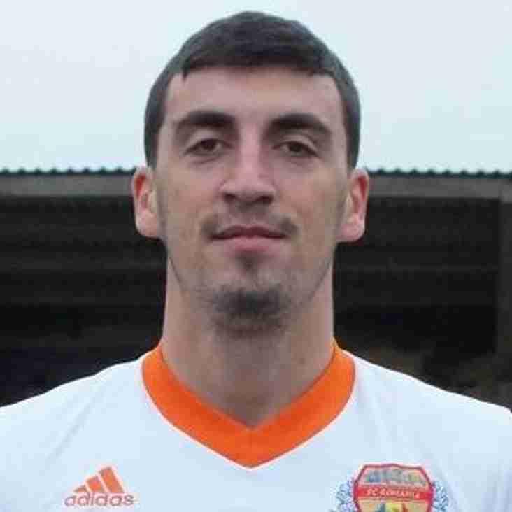 Blues Sign Romanian Defender
