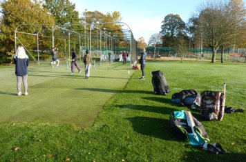 U15s in the nets. Club tennis juniors on the courts.