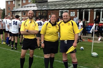 Gareth Holsgrove, RFU referee from Huntingdon, at the construction industry charity match at a sun blessed Grange Road on Friday, 22nd., May.  Our own Rachel and recently adopted Clem ran the line for him.
