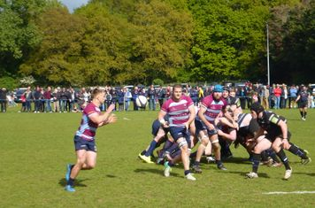 No. 8 Roy Godfrey slips the ball to scrum half Rhys Morgan