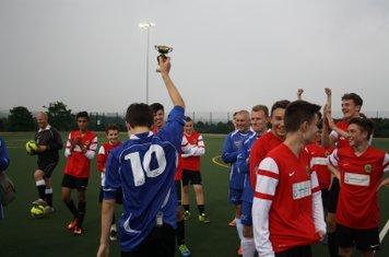 Alex Bowen holds aloft the Cup
