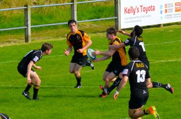 Draw a man and offload in good time. Great play by Cian and Brian.