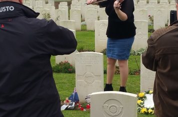 Tracy Gallaher playing at Dave Gallaher's grave
