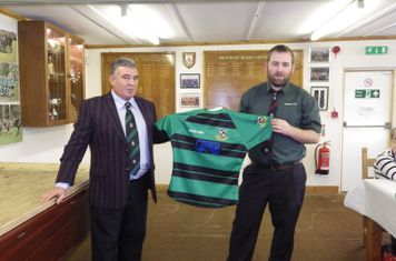 Shaun May, of Transcar Ltd, presents Chris Gillam with the new 2nd XV shirts