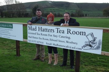 1st XV Captain, Lee Moore, with the owners of Mad Hatters Tea Room, who are one of the board sponsors of the club