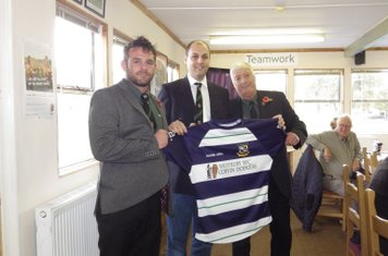 Paul Couzens, of the Coffin Dodgers, presents the new alternative strip to the 1st XV Captain, Lee Moore